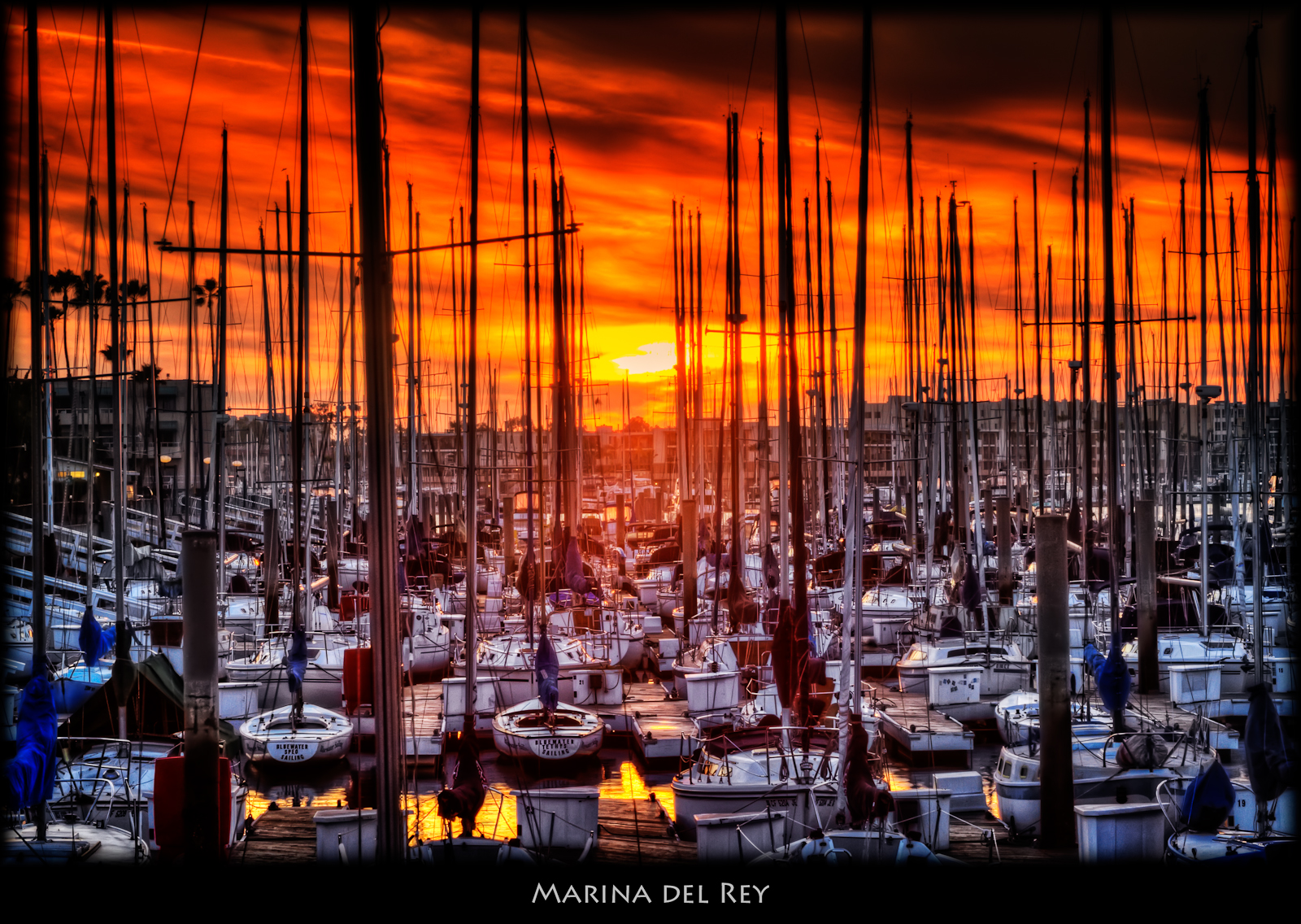 Yesterday's sunset in Marina del Rey. ISO 100, 75mm, f20, 1/8sec. Closed in on the sunset to avoid the very dark clouds further out. HDR of -2, 0, +2 exposures using Photomatix Details Enhancer. Strenght set to 30%, but smoothing set to -10 and microcontrast to +10. This produced a rather flat image, but had the sunset and the boats. Nik White Neutralizer and Tonal Contrast on the boats, Coffee Graduated Filter on the sky. In PS: overlay layer for contrast plus luminosity mask Curves. Burning around the edges.