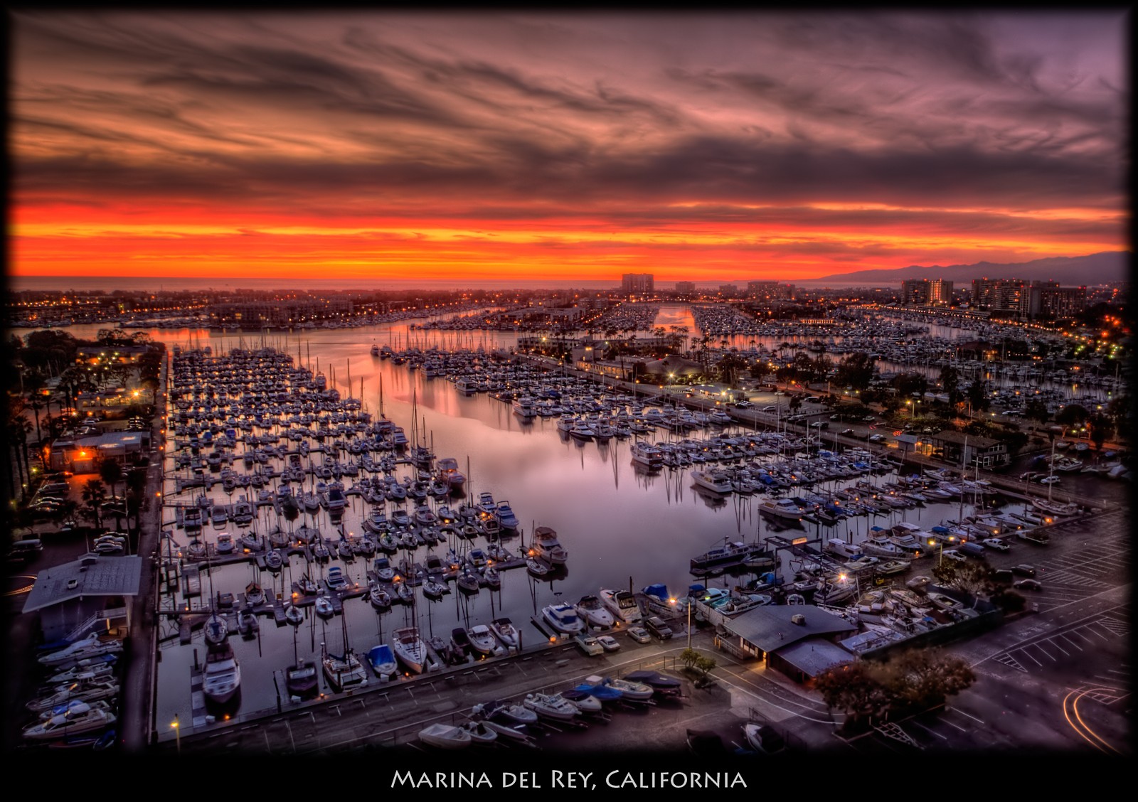 Another sunset view from my office. ISO 100, 13mm, f8, 7 exposures. Used Photomatix Details Enhancer. Followed by two rounds of noise reduction, with masks so less noise reduction was done on the boats. Used Nik Tonal Contrast to bring out the details in the boats and buildings, masking to leave the sky and sidewalks alone. Pro Contrast to neutralize the blue/purple cast and add contrast to the water and boats. Photoshop surface blur on the water to eliminate remaining noise and make the water smooth. Slight Graduated Coffee Filter and Darken/Lighten Center. Photoshop smart sharpen on the boats and buildings.