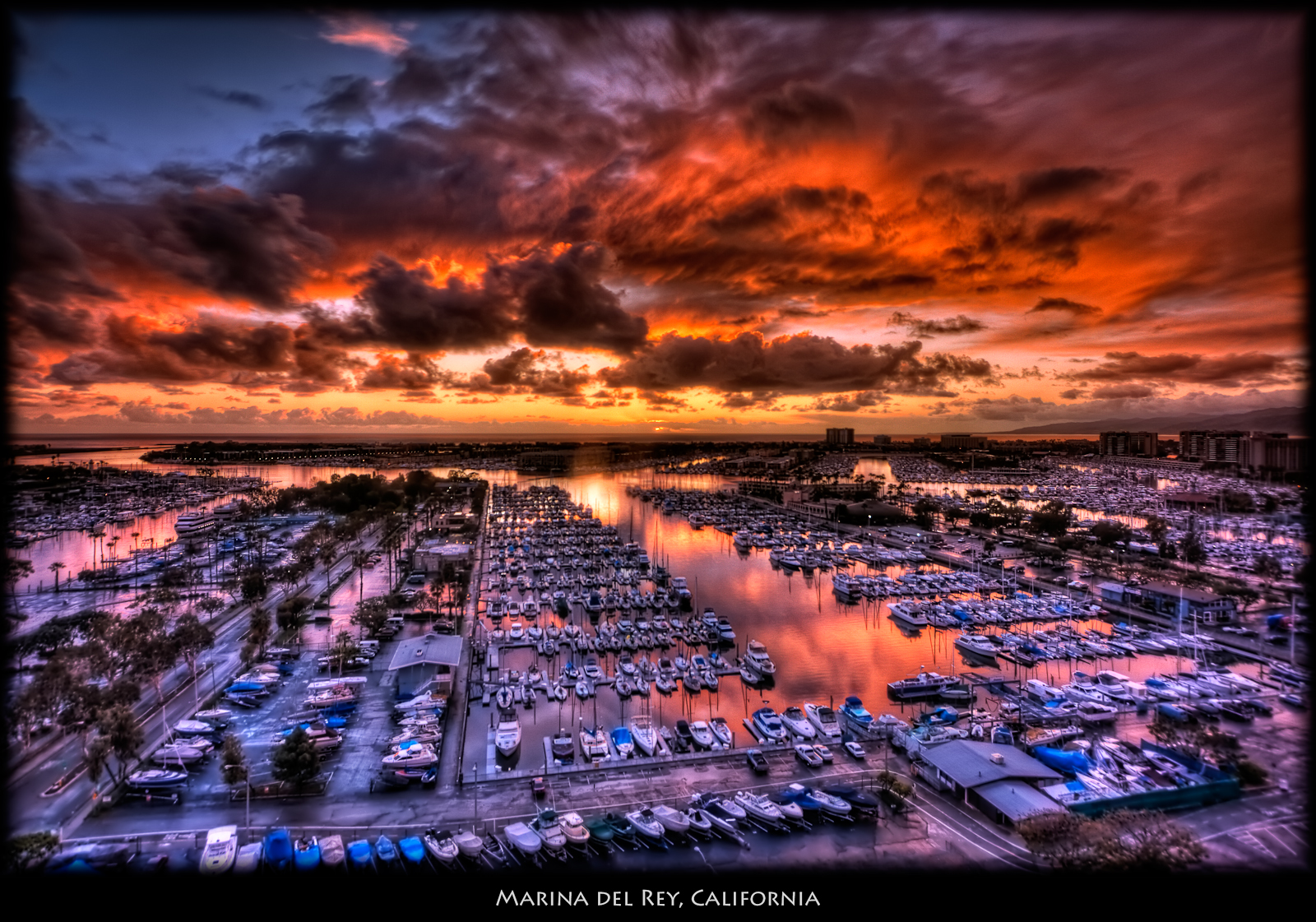 Sunset from Feb 9. It's been almost 2 months since I posted a photo. Hard to believe ... I've been very busy. This was the nicest sunset this winter when I was in my office. ISO 100, 12mm, f5. HDR of 9 exposures, 1/50 to 5 seconds. Processed inPhotomatix and Nik Color Efex: White Neutralizer and Pro Contrast to neutralize the blue/purple cast from the window tint. Slight Tonal Contrast and Graduated Filter. Imagenomic noise reduction.